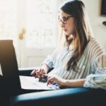 Woman studying at desk remotely